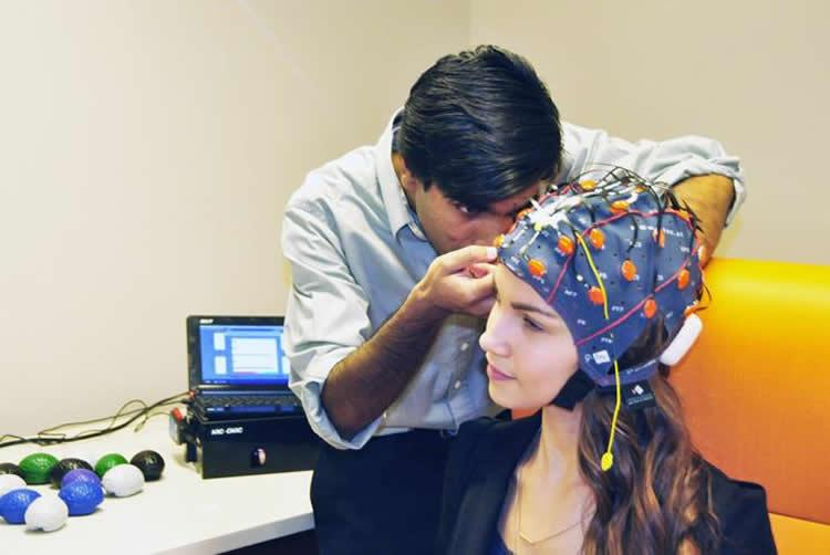 The brain vital signs platform works with any brainwave devices. Credit: Marianne Meadahl, SFU.