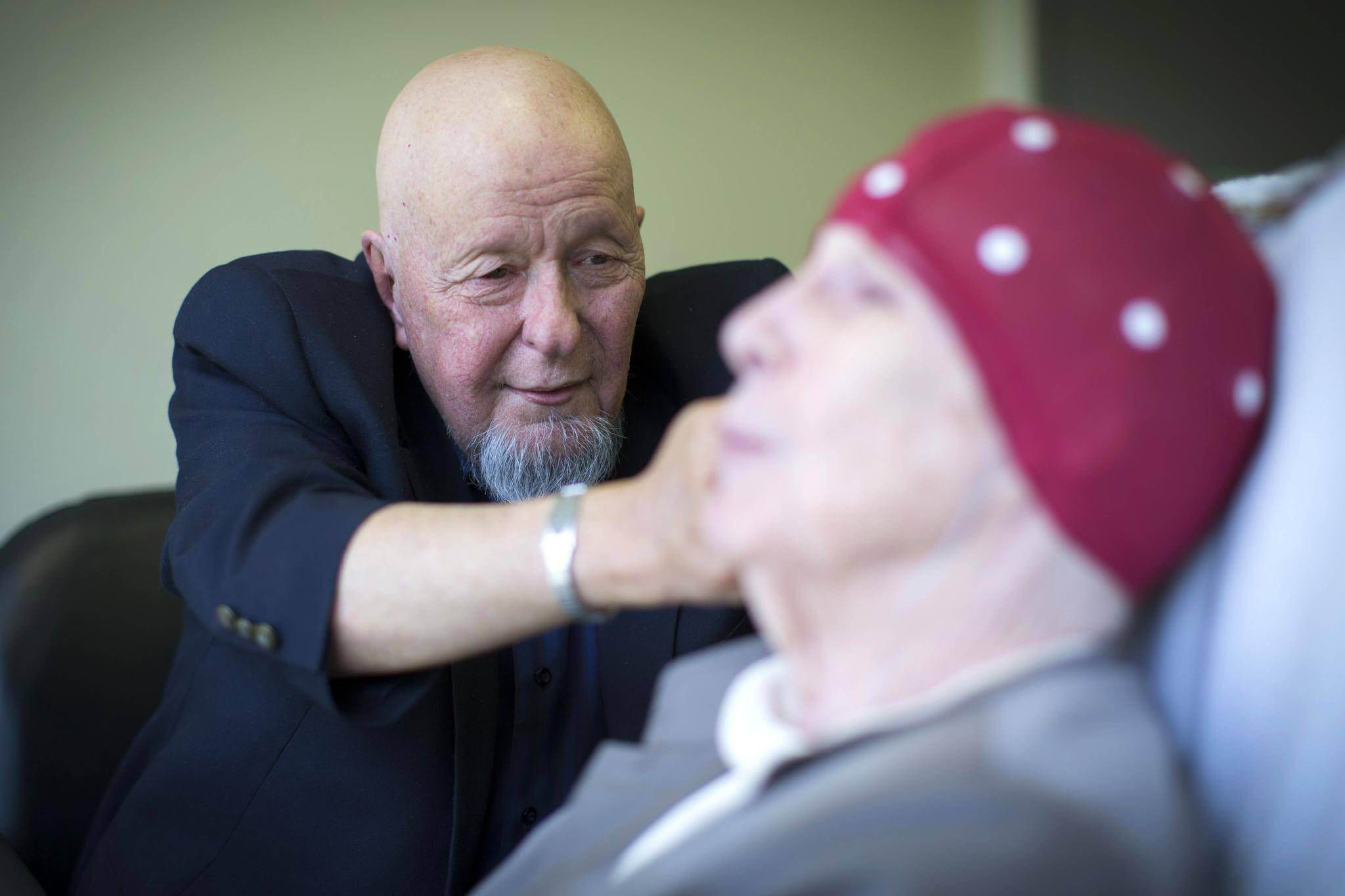 Stuart Donaldson, who runs Myosymmetries, works with a patient last month in his clinic in Calgary.