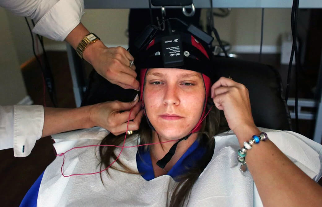 Marris Szeliga, a patient and employee of psychiatrist Hasan Asif, is fitted with an EEG cap that will allow him to analyze her brain-wave activity