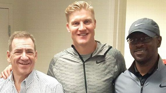 McCown, flanked by William Lambos (left) and Tommy Shavers (right) after a game last season. Both work closely with McCown in his cognitive training. Courtesy Josh McCown